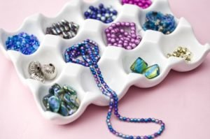 colored beads on white tray