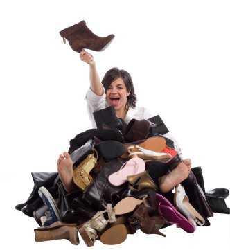 Woman in a pile of shoes