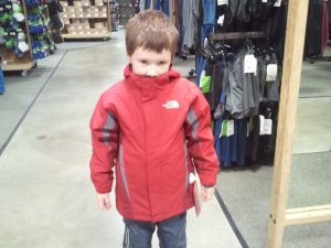 Boy Bundled in Jacket